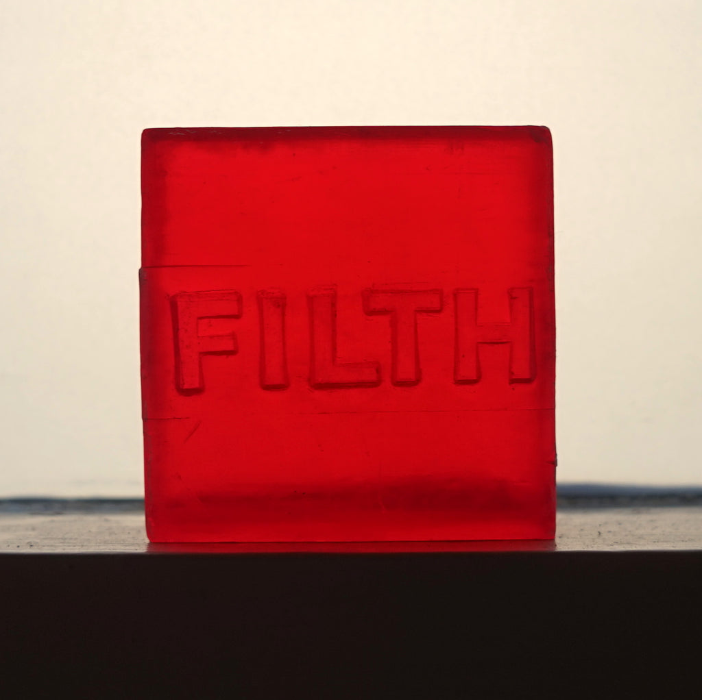 Dirty glycerine soap branded with the word Filth.