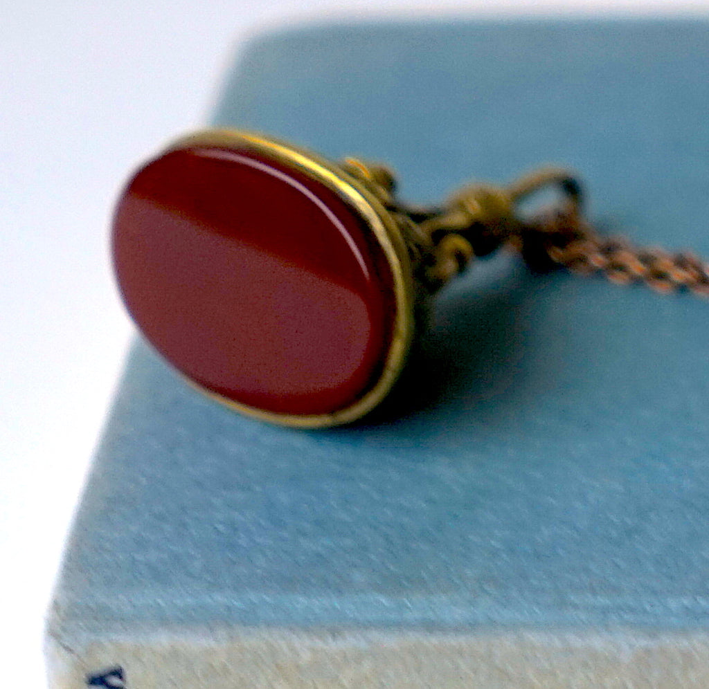 Gold coloured Antique pocket Watch fob and oxidised silver chain