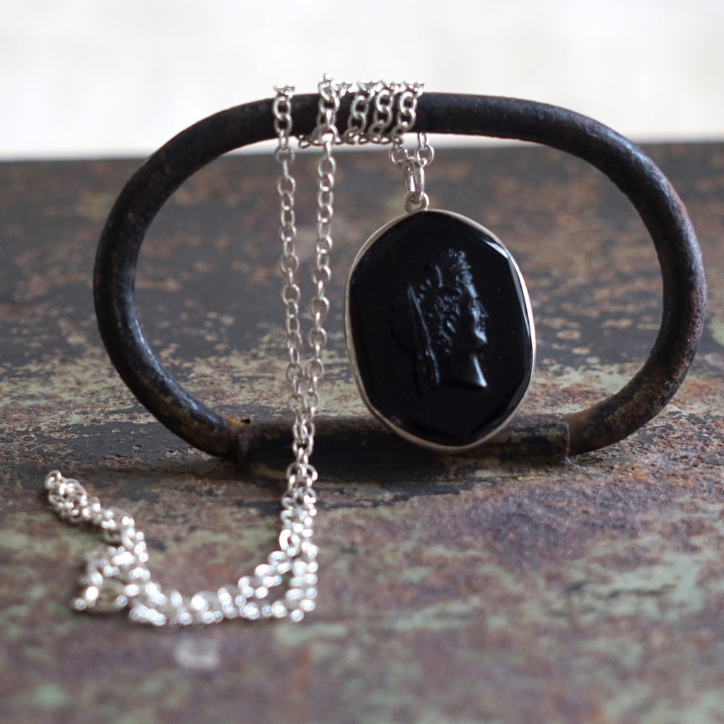 Victorian black pressed Glass Head & Silver Necklace.