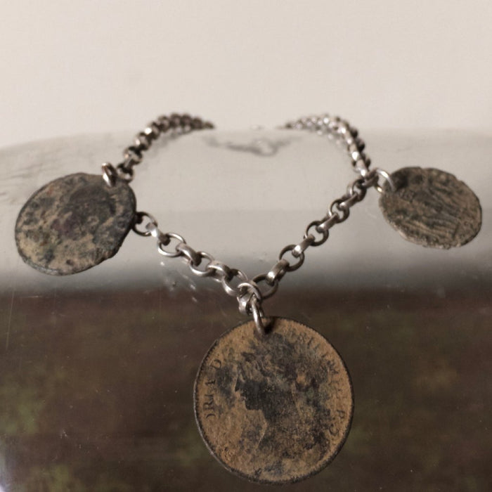 Silver charm bracelet with Roman Coins