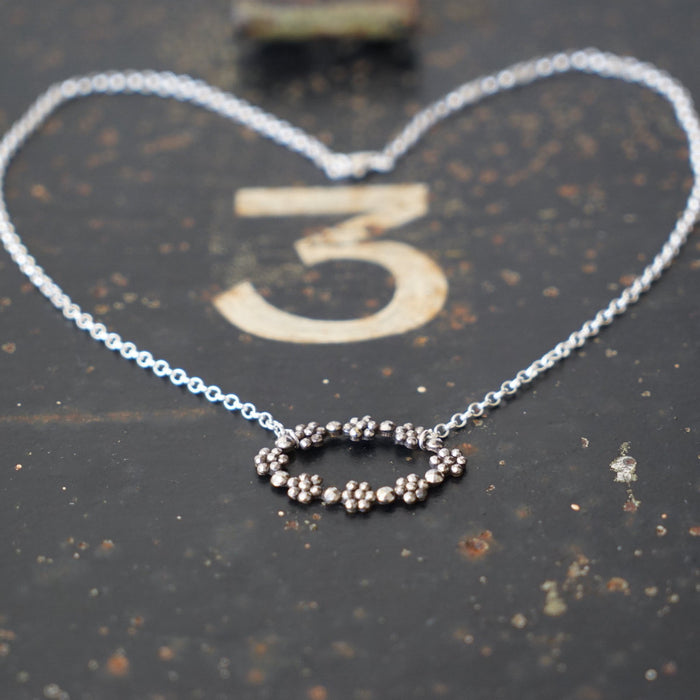 Oval floral Cut Steel  and Silver Necklace.
