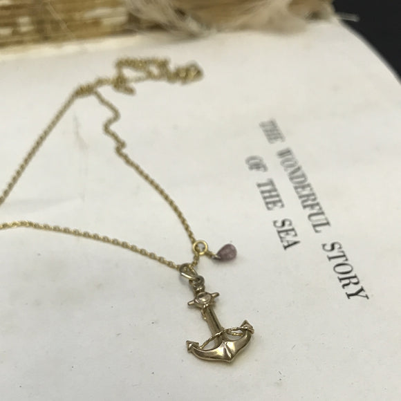 Gold Anchor charm necklace.