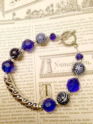Calligraphy-Inspired Blue Bead Bracelet