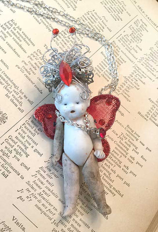 Creepy Doll Necklace with Red Wings