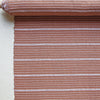 Terracotta and natural horizontal stripe textile by Kufri Life