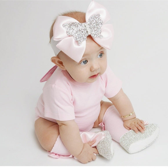 pink baby grow with short sleeves