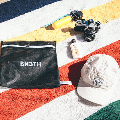 Beach essentials in the BN3TH reusable pouch. Perfect for rad summer adventures!