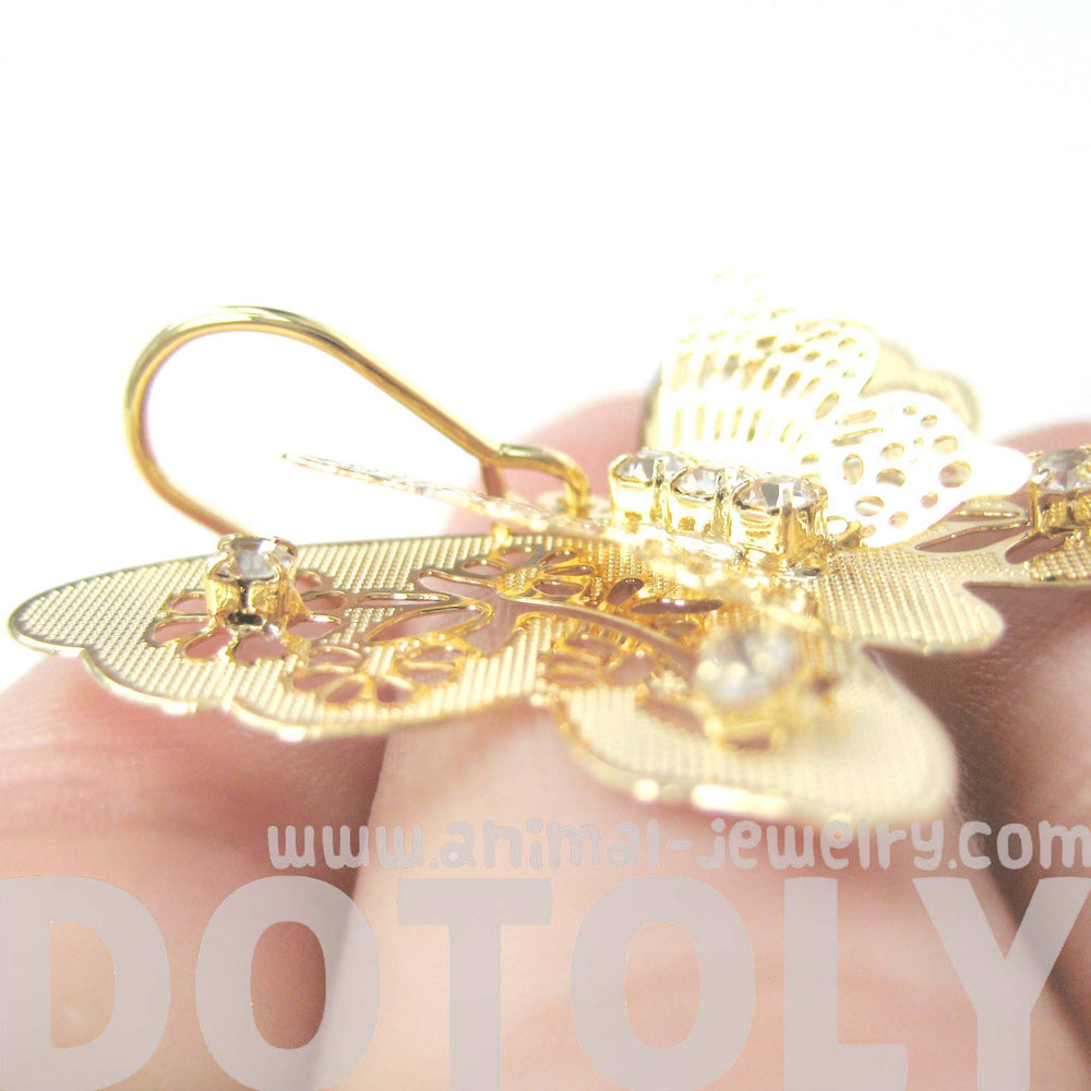 3D Butterfly Shaped Dangle Earrings in Gold With Floral Cut Out Details | DOTOLY | DOTOLY