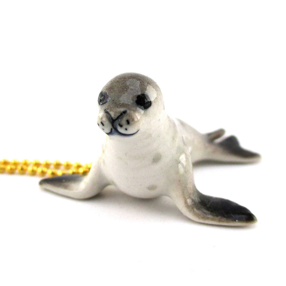 Little Monk Seal Shaped Pendant Necklace by DOTOLY