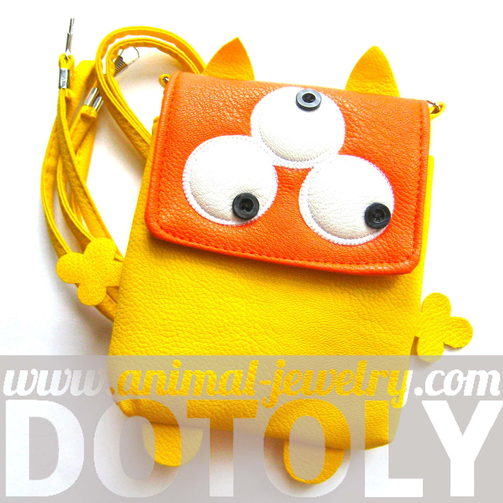 Three Eyed Monster Small Cross Body Shoulder Bag Purse in Yellow | DOTOLY
