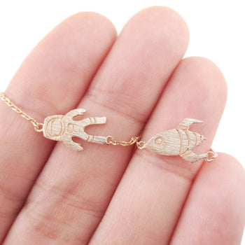 Spaceship and Astronaut Space Travel Themed Charm Necklace in Rose Gold | DOTOLY | DOTOLY
