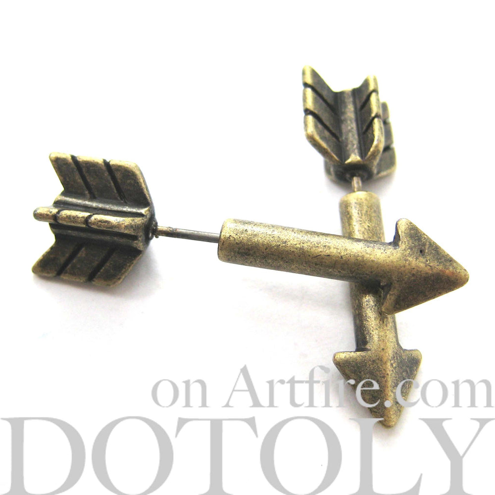 Fake Gauge Earrings: Realistic Arrow Shaped Faux Plug Stud Earrings in Brass | DOTOLY