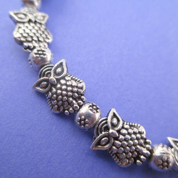 A Row Of Owls Shaped Beaded Stretchy Bracelet in Silver | DOTOLY
