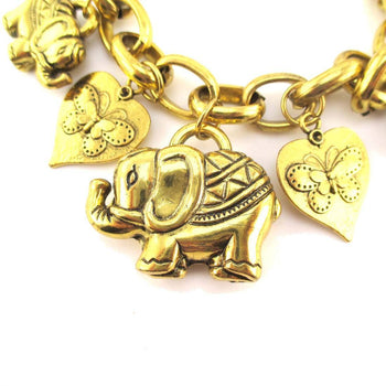 Abstract Elephant and Coins Shaped Charm Bracelet in Gold | Animal Jewelry | DOTOLY
