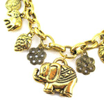 Abstract Elephant and Coins Shaped Charm Necklace in Gold | Animal Jewelry | DOTOLY