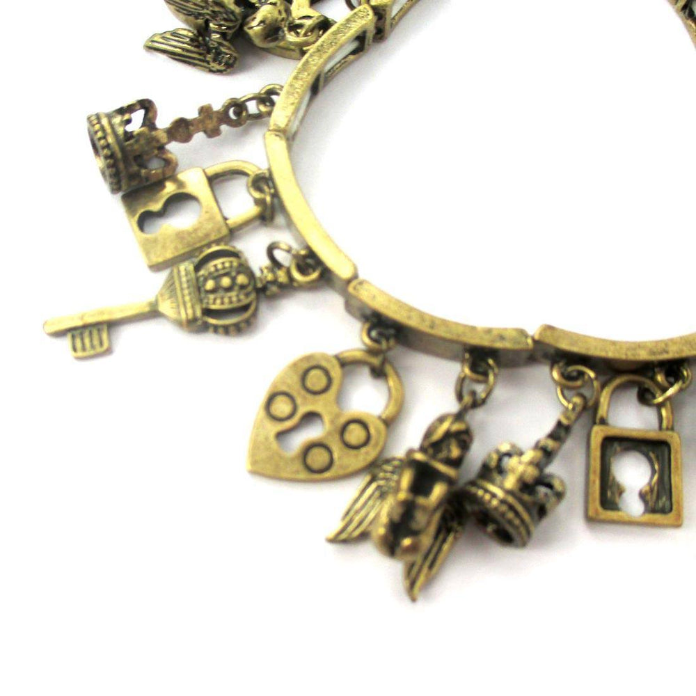 Angels Skeleton Key and Lock Shaped Charm Bracelet in Brass | DOTOLY