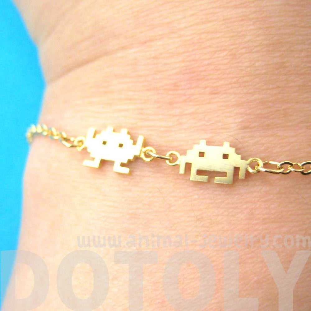 Atari Space Invaders Arcade Themed Alien Pixel Charm Bracelet in Gold | DOTOLY