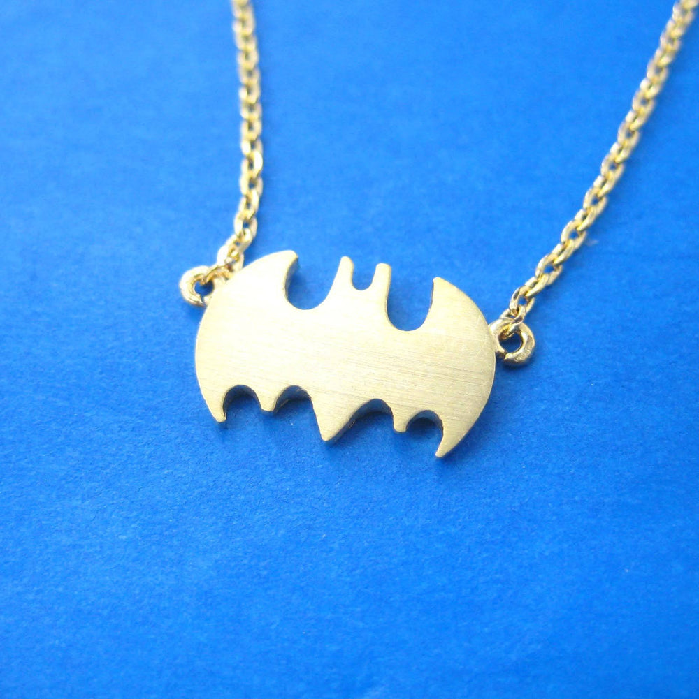 Batman Logo Bat Shaped Silhouette Symbol Charm Necklace in Gold | DOTOLY | DOTOLY
