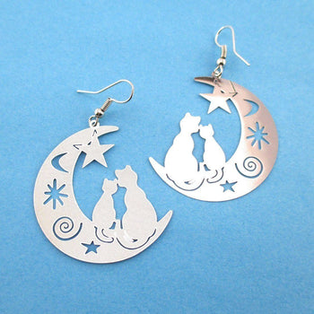 Cats on a Crescent Moon Cut Out Silhouette Shaped Dangle Earrings in Silver | Animal Jewelry | DOTOLY