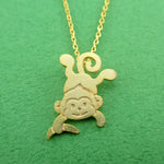 Dangling Cheeky Monkey With A Banana Shaped Pendant Necklace in Gold | DOTOLY
