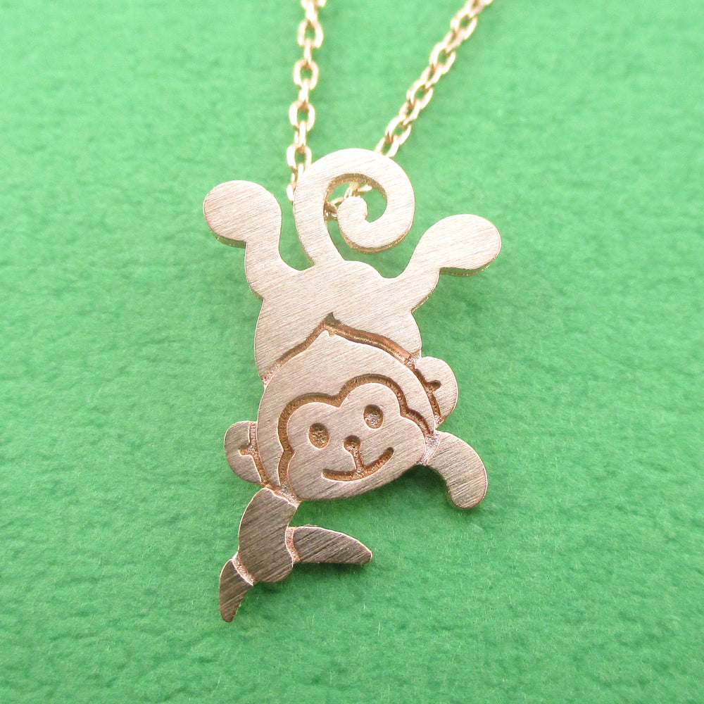 Dangling Cheeky Monkey With A Banana Shaped Pendant Necklace in Rose Gold | DOTOLY