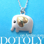 small-elephant-animal-charm-necklace-in-silver-with-gold-heart-detail