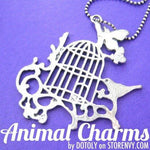 Bird Cage Silhouette Pendant with Birds Butterflies and Floral Detail in Silver | DOTOLY