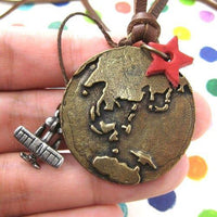 Globetrotter Travel Earth and Airplane Pendant Necklace in Bronze | DOTOLY