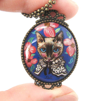 Fancy Kitty Cat Shaped Illustrated Oval Pendant Necklace in Blue with Roses | DOTOLY