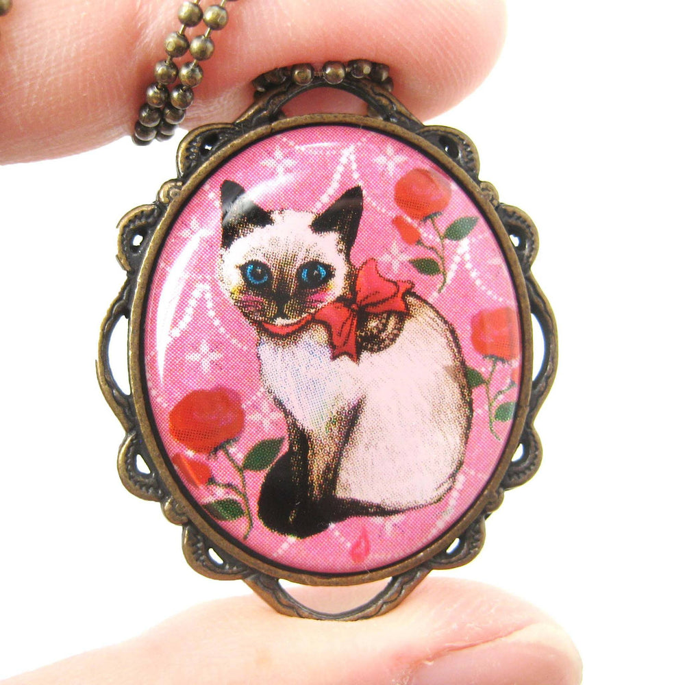 Fancy Siamese Kitty Cat Shaped Illustrated Oval Pendant Necklace in Pink with Bows and Roses | DOTOLY