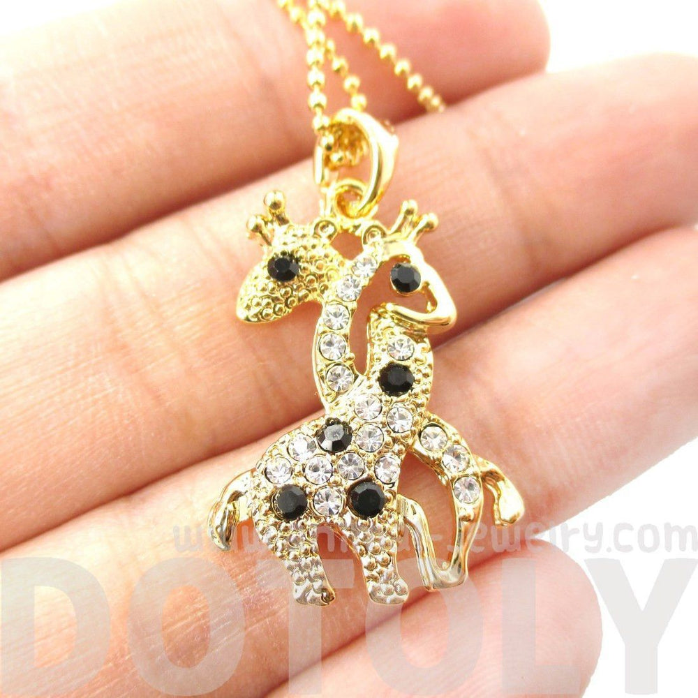 Giraffes with Necks Entwined Animal Shaped Pendant Necklace in Gold with Rhinestones | DOTOLY