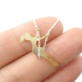 Girl Swinging on a Swing Acrobat Charm Necklace in Silver and Gold | DOTOLY | DOTOLY