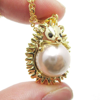 Hedgehog Porcupine Hugging a Pearl Shaped Animal Pendant Necklace in Gold | DOTOLY