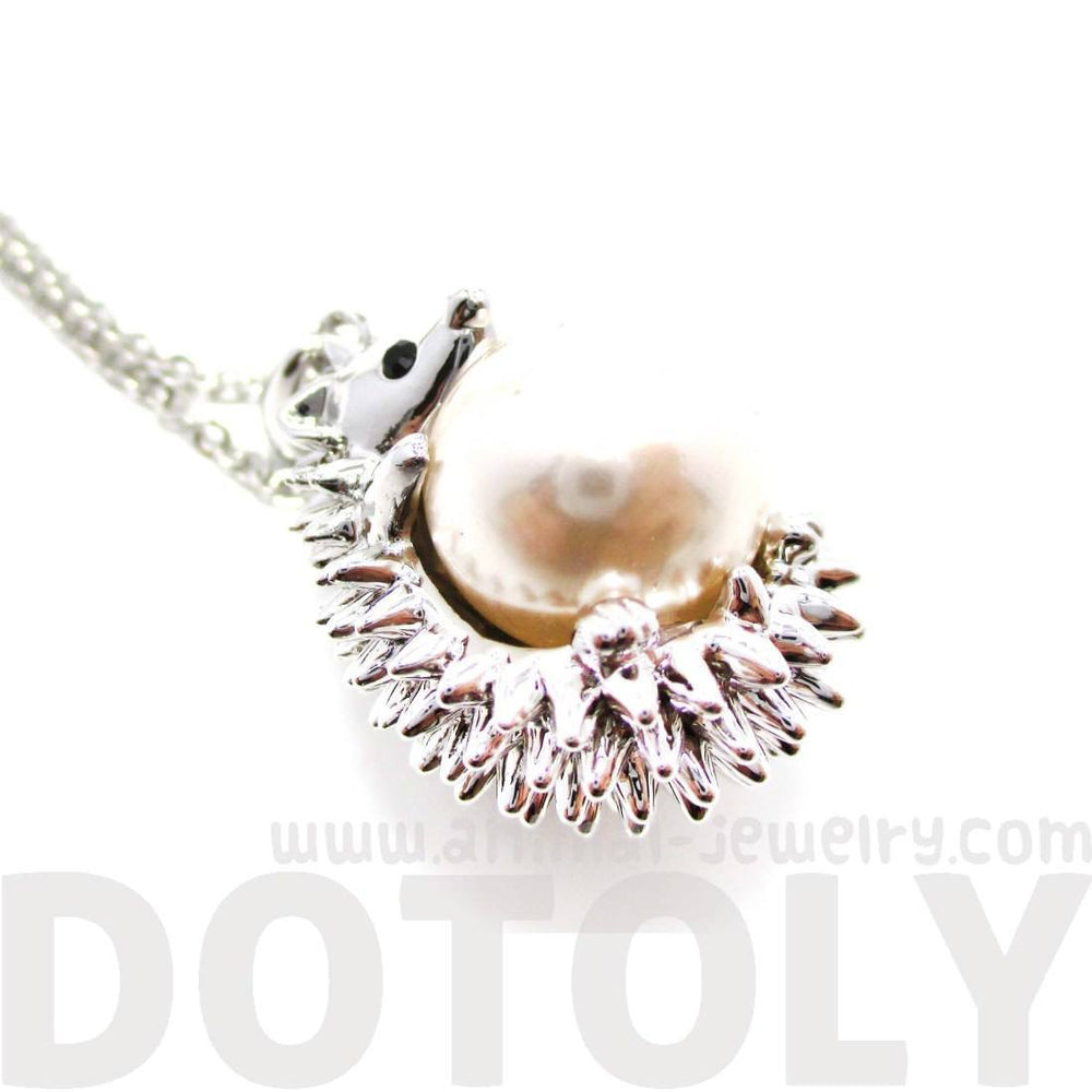Hedgehog Porcupine Hugging a Pearl Shaped Animal Pendant Necklace in Silver | DOTOLY
