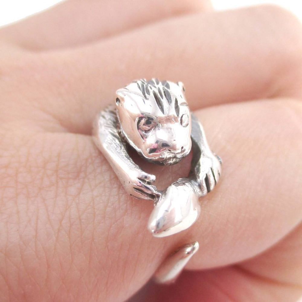 Holding a Fish Shaped Animal Wrap Around Ring in 925 Sterling Silver