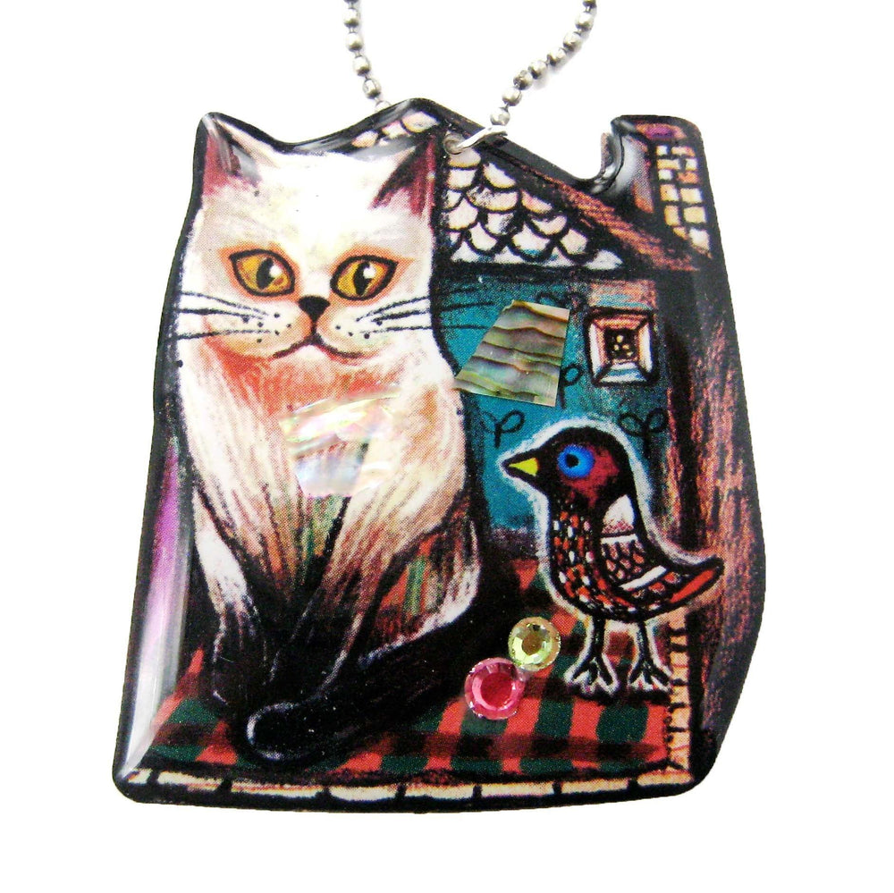 Kitty Cat in Front of A House with a Bird Shaped Illustrated Resin Pendant Necklace | DOTOLY