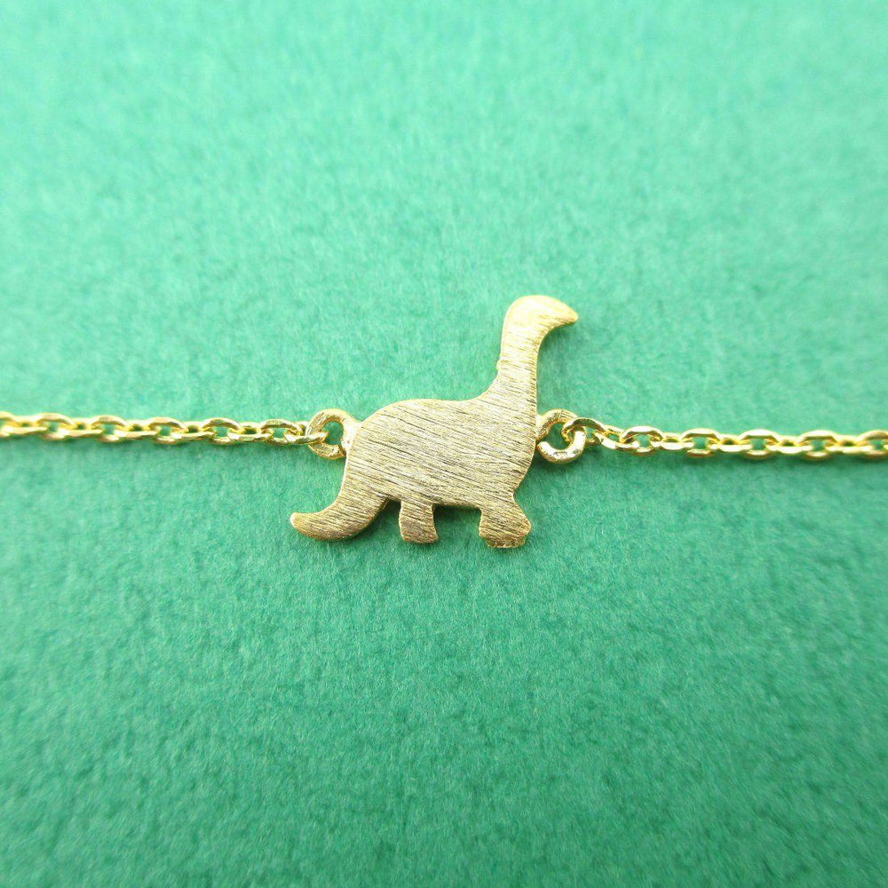Long Neck Dinosaur Sauropoda Silhouette Shaped Charm Bracelet in Gold | DOTOLY