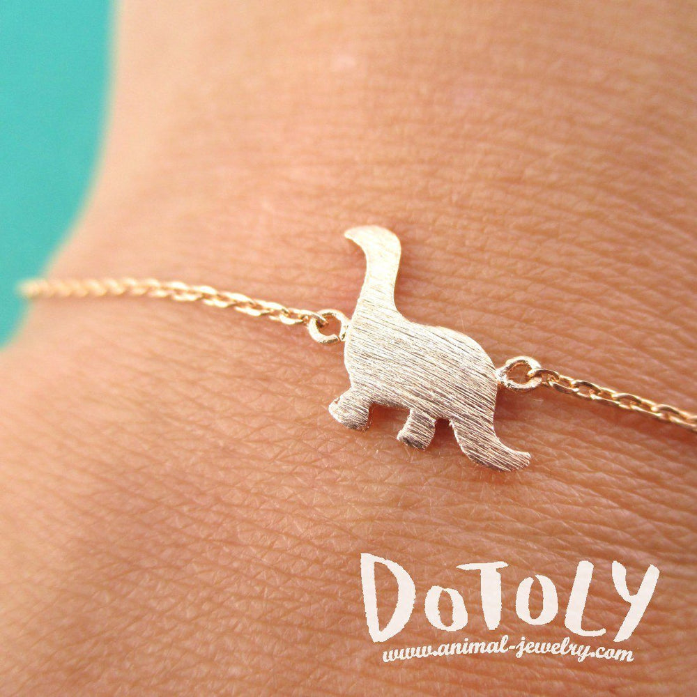 Long Neck Dinosaur Sauropoda Silhouette Shaped Charm Bracelet in Rose Gold | DOTOLY