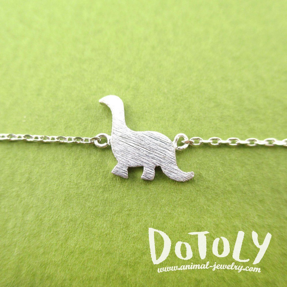 Long Neck Dinosaur Sauropoda Silhouette Shaped Charm Bracelet in Silver | DOTOLY