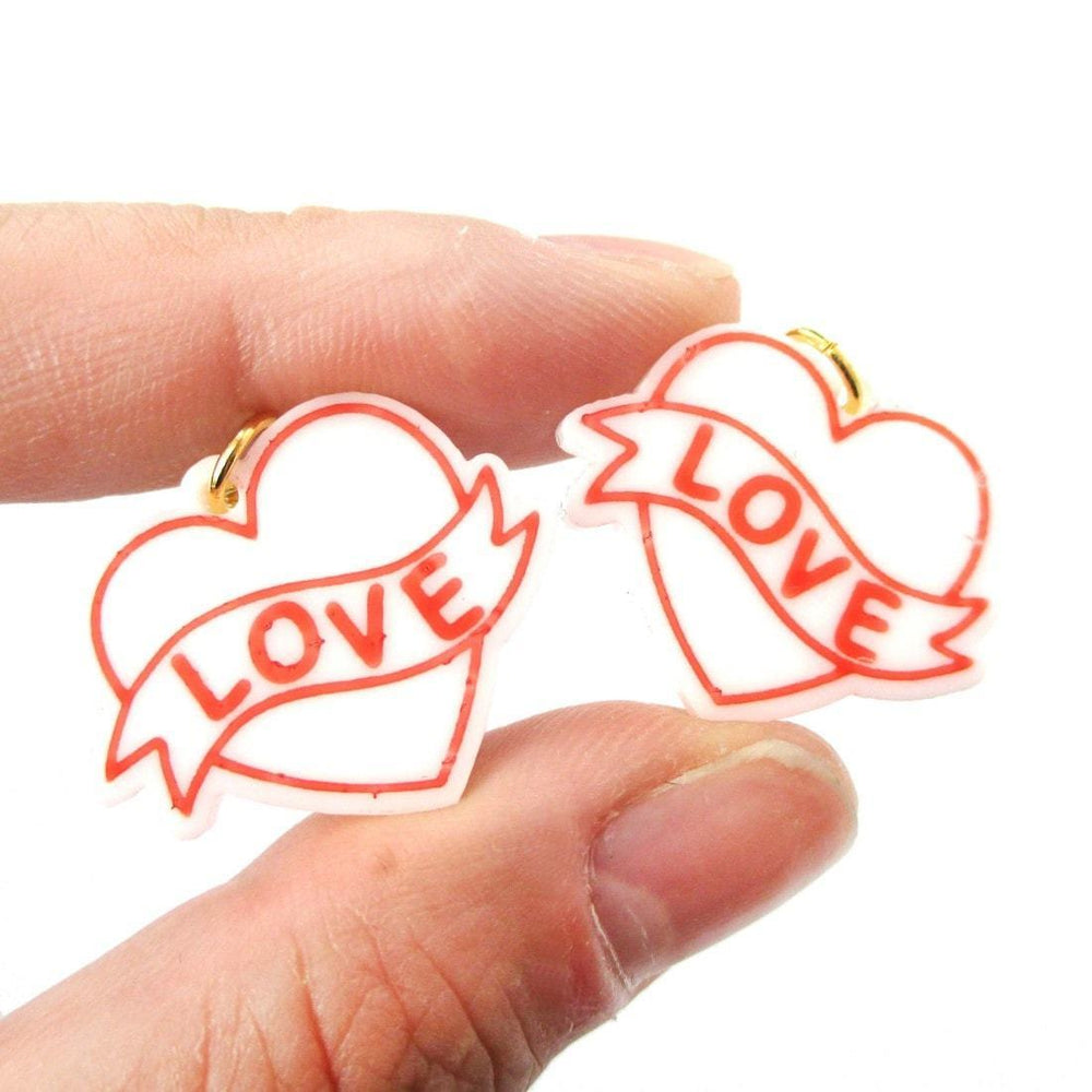 Love Banner Tattoo Heart Shaped Laser Cut Dangle Clip On Earrings in White | DOTOLY