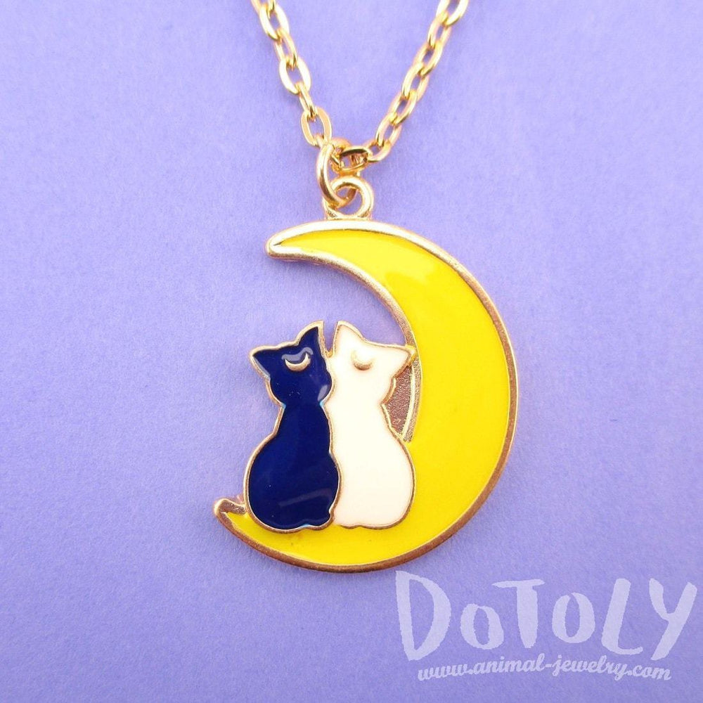 Luna and Artemis Silhouette on a Crescent Moon Shaped Pendant Necklace | Sailor Moon | DOTOLY