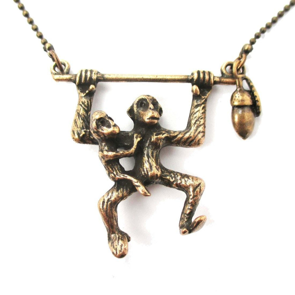 Mother and Baby Chimpanzee Monkey Swinging Shaped Animal Pendant Necklace in Bronze | DOTOLY