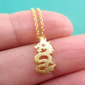 Mythical Dragon Silhouette Shaped Pendant Necklace in Gold | DOTOLY