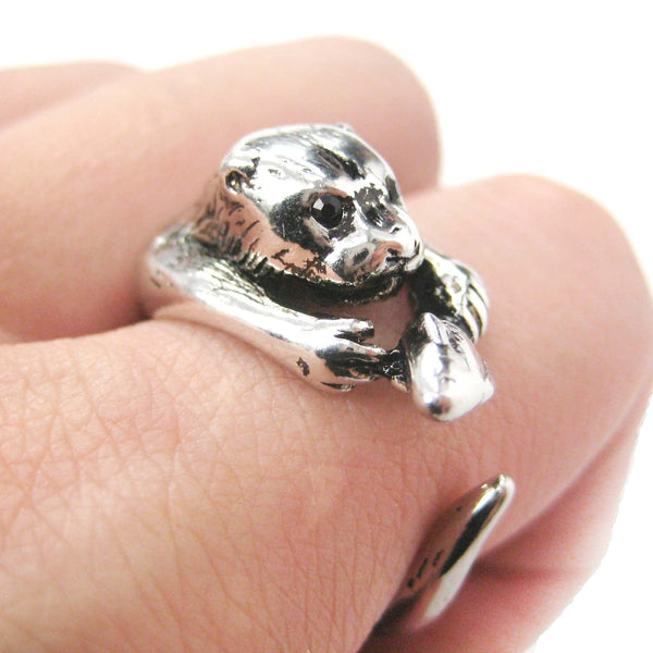 Otter Holding a Fish Shaped Animal Wrap Around Ring in Shiny Silver | US Sizes 4 to 9 | DOTOLY