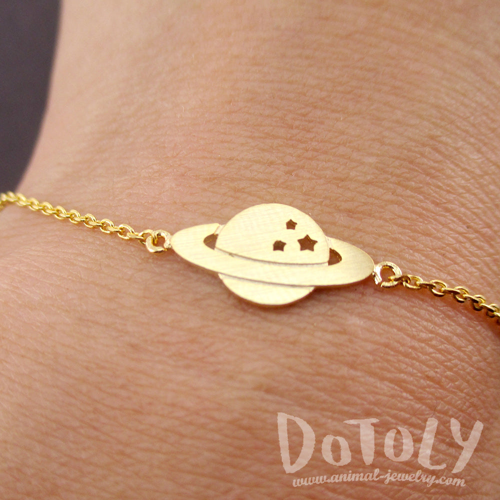 Saturn Shaped Charm Bracelets. Space Travel Themed NASA Bracelet in Gold