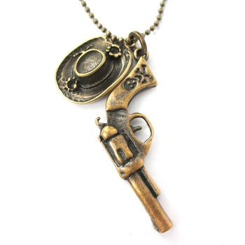 Realistic Gun Pistol Revolver and Cowboy Hat Shaped Pendant Necklace in Bronze | DOTOLY | DOTOLY
