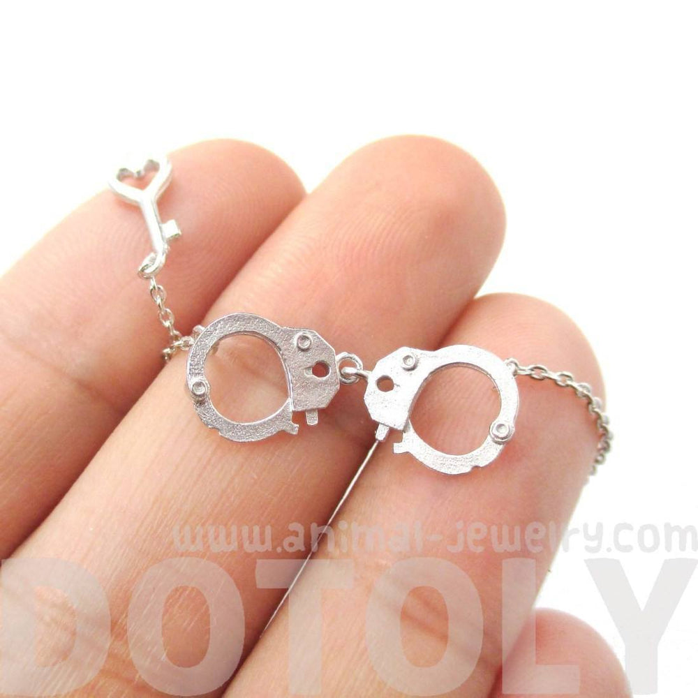 Realistic Handcuff and Heart Shaped Key Charm Necklace in Silver | DOTOLY | DOTOLY