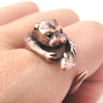 Realistic Otter Holding a Fish Shaped Animal Wrap Ring in Copper | US Sizes 4 to 9 | DOTOLY