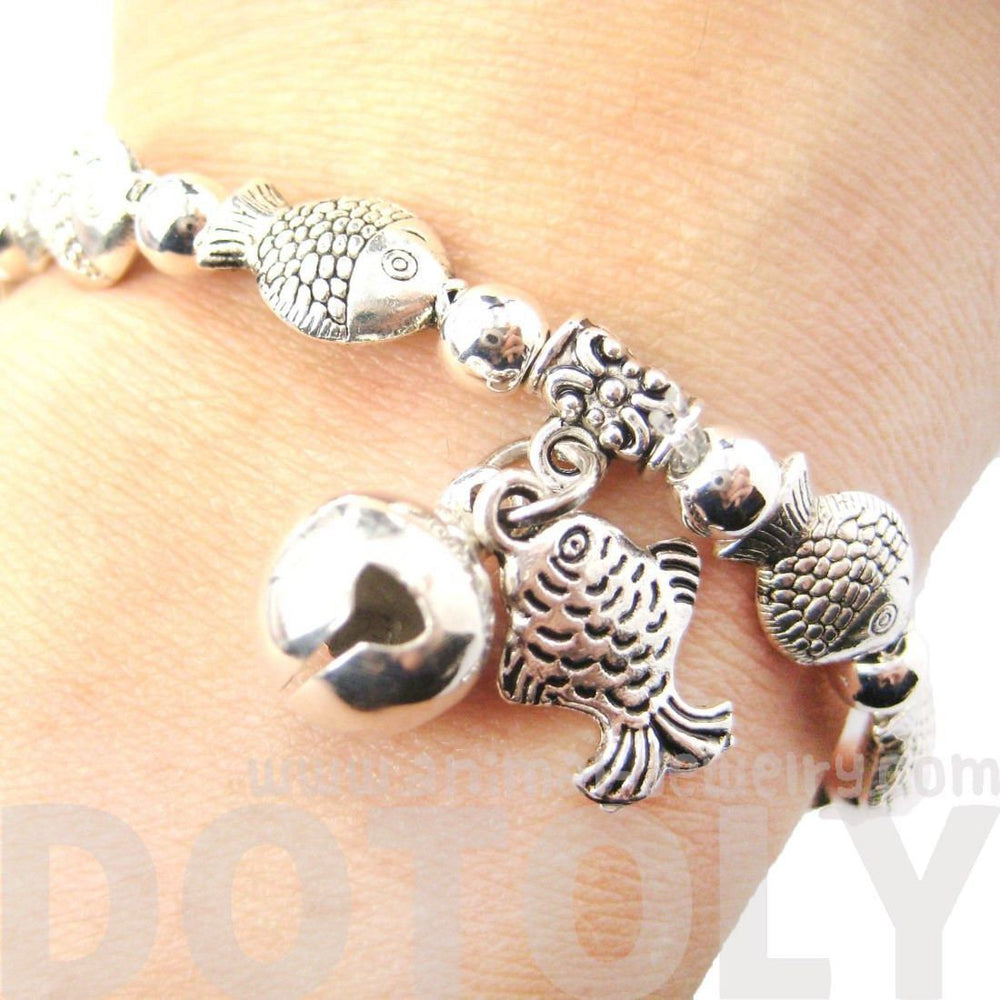 Row Of Fish Shaped Sea Animal Stretchy Bracelet in Silver | Animal Jewelry | DOTOLY