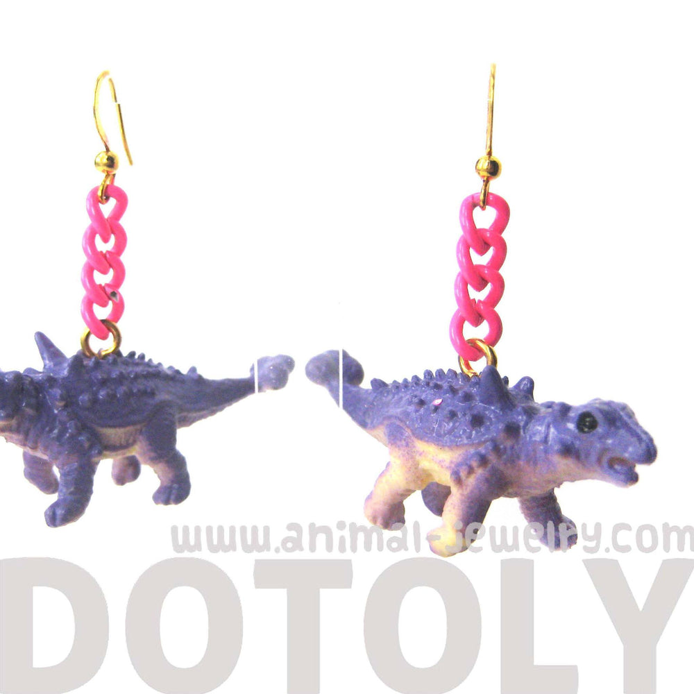 Scolosaurus Euoplocephalus Dinosaur Animal Figurine Shaped Dangle Earrings in Purple | DOTOLY